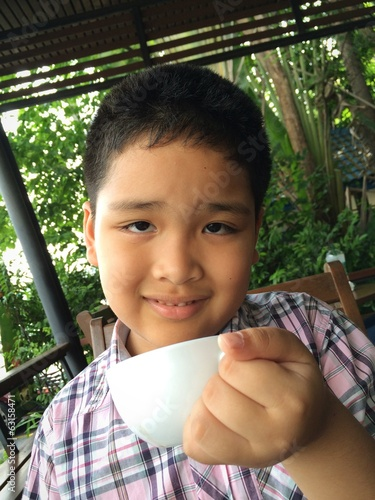 boy enjoy hot drink