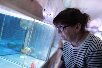 Senior woman at oceanarium