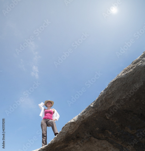 Beautiful girl on a rock