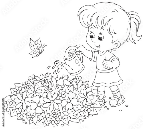 girl watering flowers on a flowerbed