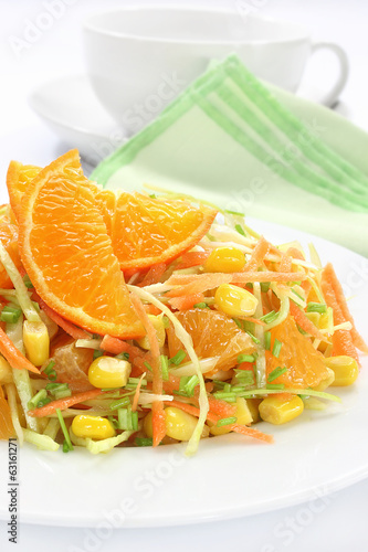 Salad with cabbage, carrots, mandarin and sweet corn