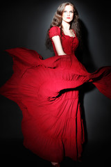 Fashion woman in red flying dress