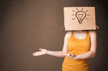 Young woman gesturing with a cardboard box on her head with ligh