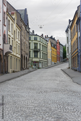 view on streets and houses at city of Alesund , Norway