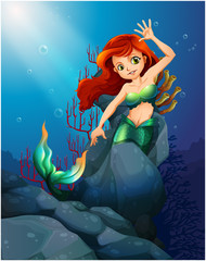 A pretty mermaid trapped with the big rocks under the sea
