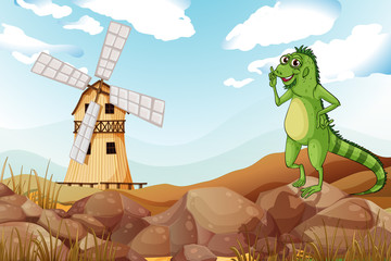 A smiling lizard across the wooden barnhouse with a windmill