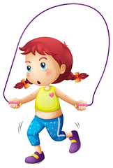 A cute little girl playing skipping rope