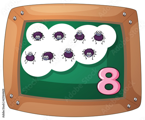 A blackboard with eight insects