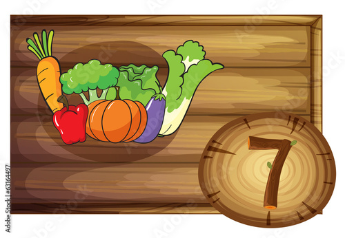 A wooden frame with seven vegetables