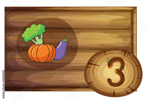 A wooden frame with three vegetables