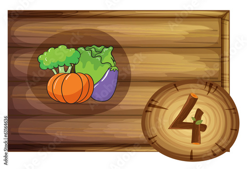 A wooden frame with four vegetables