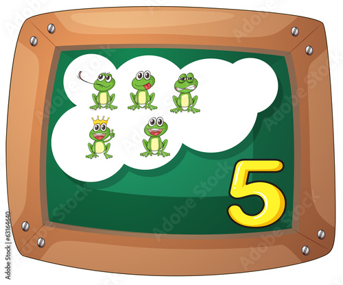 A blackboard with five frogs