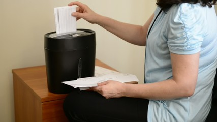 Woman Shredding Papers