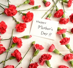 """""""Mothers day""""message card on red carnations background"""