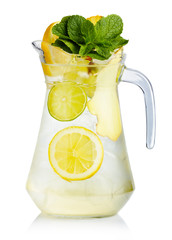 Full jug of fresh birch juice with lemon, ginger and mint leaves
