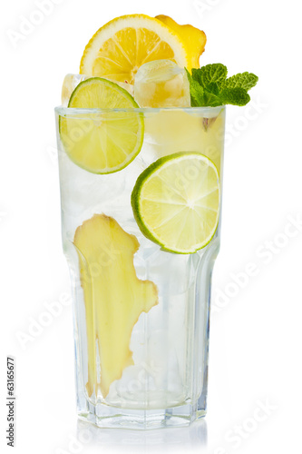 Full glass of fresh birch juice with lemon, ginger and mint leav