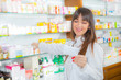 Portrait of a smiling female pharmacist with prescription