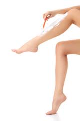 Female shaves her legs