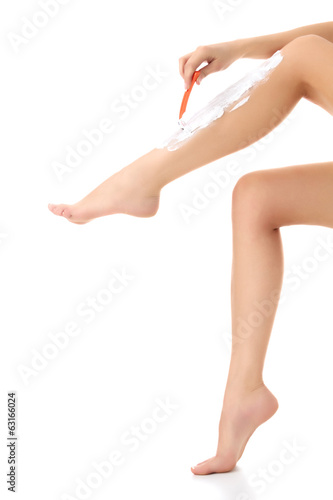 Female shaves her legs