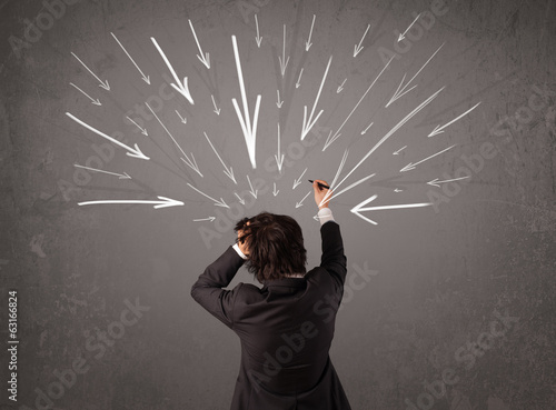 Business man with hand drawn arrows pointing at his head