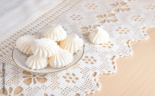 Meringue on a lacy cloth.