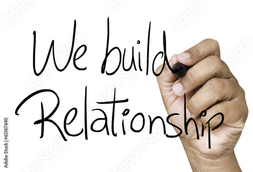 We build relationship hand writing on white marker