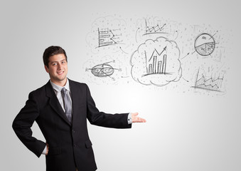 Business man presenting hand drawn sketch graphs and charts