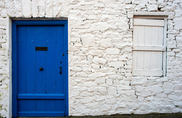 blue door and stone work detail of old Irish cottage