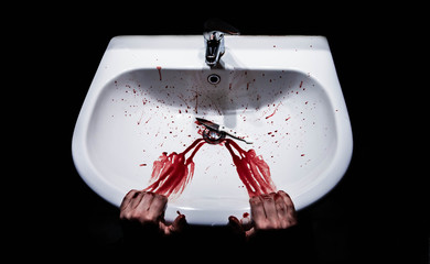 Suicide concept - bleeding hands and knife in a sink