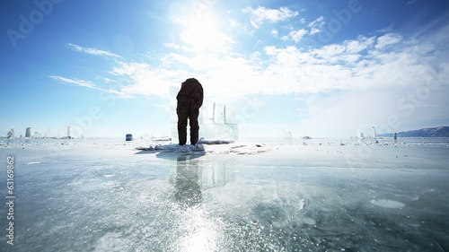 Man Cuts Ice, Preparing the ice for further processing
