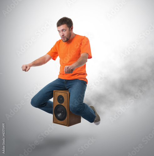 Unreal flying man on wooden speaker