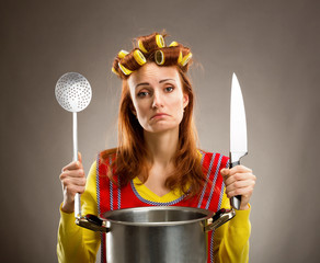 Sad housewife with sause pan