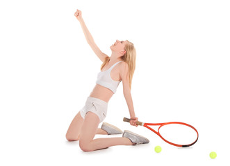 attractive young woman celebrating after winning a tennis