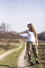 young woman .hitch-hike