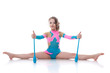 Cute gymnast posing sitting on splits with mace