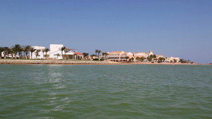 View of houses and hotels from boat floating on channels of El G