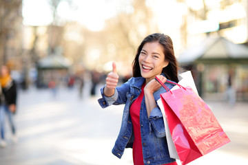 Shopping woman thumbs up on La Rambla, Barcelona