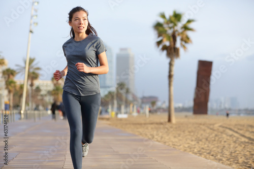 Running woman jogging Barcelona Beach Barceloneta