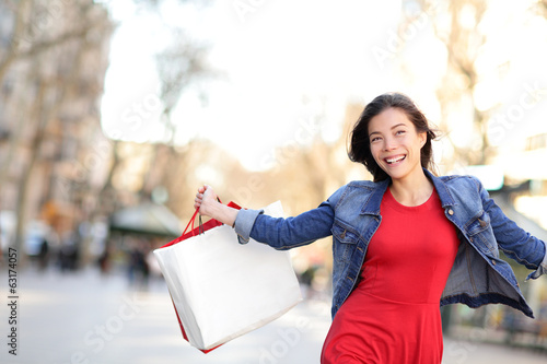 Shopping girl happy shopping outside