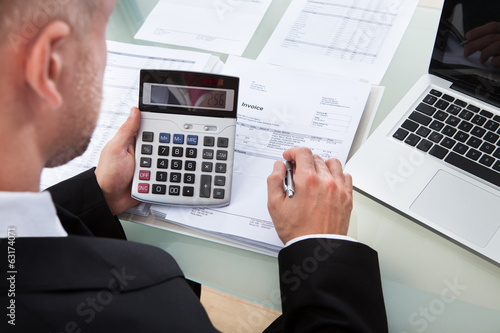 Businessman checking figures in a report
