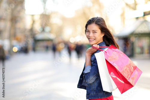 Woman shopping - shopper girl outdoors