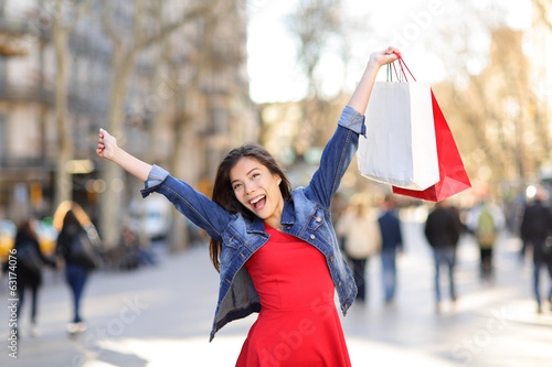 Happy shopping woman on La Rambla street Barcelona