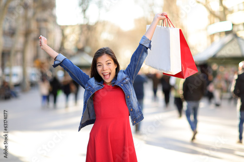 Shopping woman happy on La Rambla street Barcelona