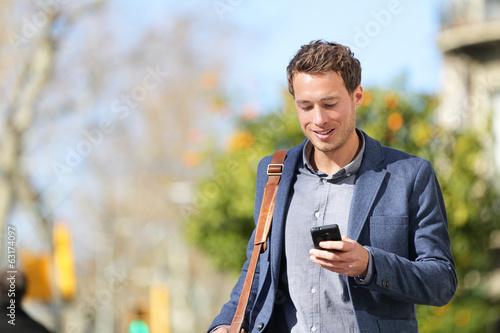 Leinwanddruck Bild Young urban businessman professional on smartphone
