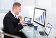 Businessman celebrating a performance graph