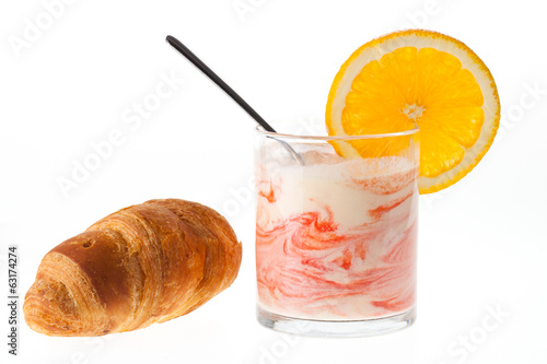 Breakfast with croissant, orange, and yogurt