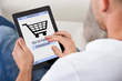 Conceptual image of a man making an online purchase
