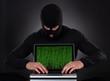 Hacker stealing data of a laptop computer