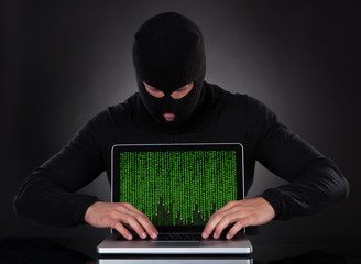 Hacker stealing data of a laptop computer