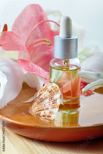 Essential oil for spa treatment in bottle with dropper